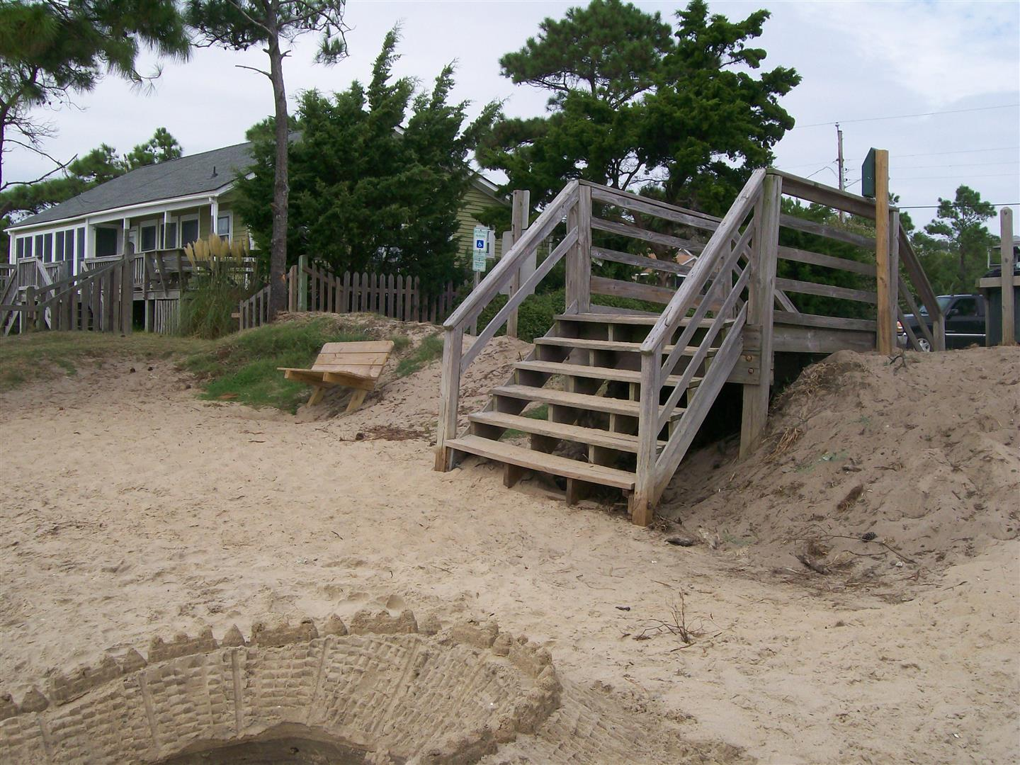 Wooden Stairs Leading to Beach With House in Background
